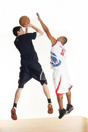 Two Guys Playing Basketball